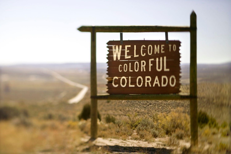 Dog-friendly Hike Denver - colorful Colorado sign